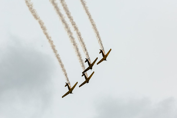 Four planes fly in formation, releasing smoke over the Ohio River during Thunder on Saturday. Staff Photo By Josh Hicks