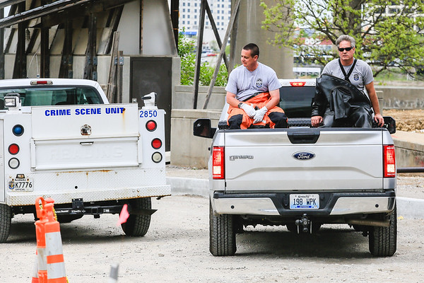 Louisville Metro River Patrol exits from under the Kennedy Bridge after recovering a body that washed ashore Tuesday afternoon. Staff Photo By Josh Hicks
