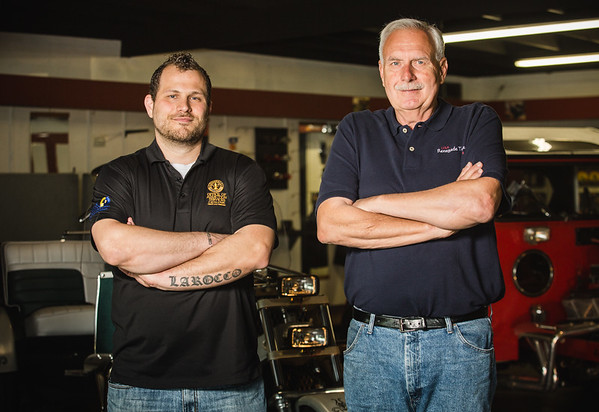 Matt Larocco, left, stands with Ron Uesseler in Renegade Trike's showroom in Clarksville. Before Larocco worked for Louisville's Office of Addiction Services, Uesseler at the trike shop during a time when no one else would give him a chance. Staff Photo By Josh Hicks