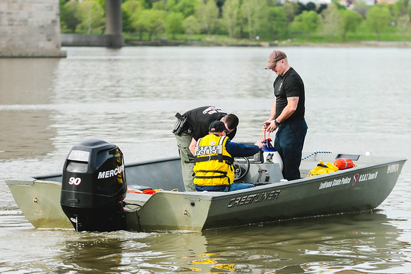 State Police gear up on the Jeffersonville shoreline Tuesday as they search for an individual that was reported seen struggling in the water Monday afternoon. Staff Photo By Josh Hicks