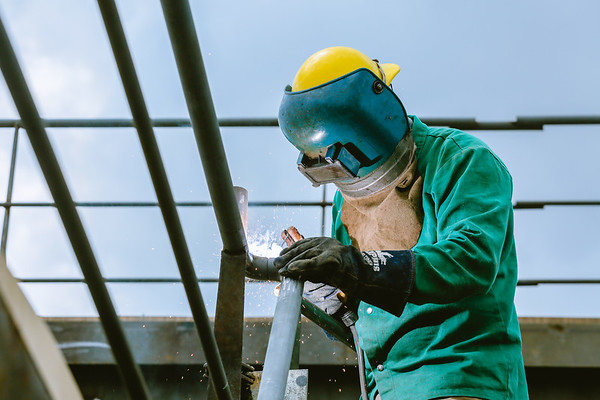 A welder at Jeffboat works on securing a handrail on Thursday. Staff Photo By Josh Hicks