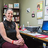 Alice Maynor, the Clinical Manager of Turing Point Center in Jeffersonville, decorates her office with bright colors in order to keep spirits high when tackling addiction. Staff Photo By Josh Hicks