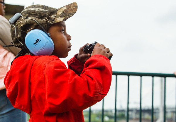 Louis Prechtel, 4, takes out a pair of binoculars to get a closer look at the air show during Thunder over Louisville on Saturday. Staff Photo By Josh Hicks