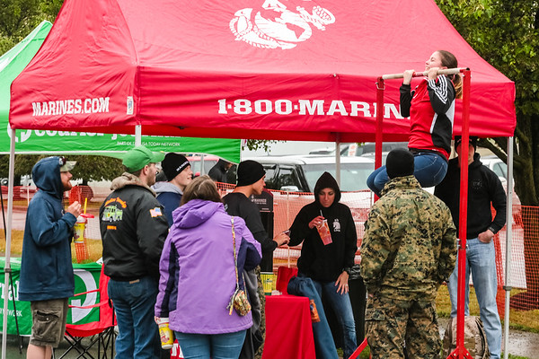 Kendra Black does pull ups at the Marines' tent during Thunder on Saturday. Staff Photo By Josh Hicks