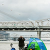 A Thunder spectator comes out of his tent on the Jeffersonville riverside on Saturday. Staff Photo By Josh  Hicks
