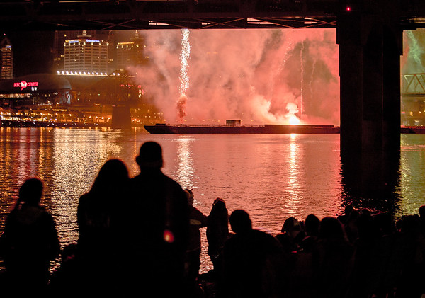 A barge launches fireworks during Thunder on Saturday. Staff Photo By Josh Hicks