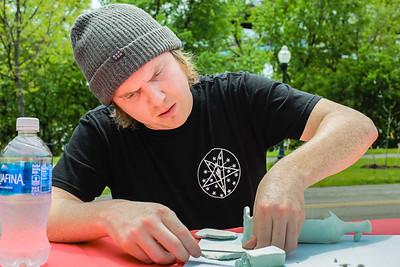 New Albany BMX rider Jake Denham flattens clay into an idea he has for the New Albany Riverfront Skatepark. Staff Photo By Josh Hicks