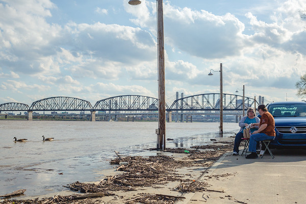 Linda, left, and Alvin Stepp eat a picnic dinner on the edge of the Ohio River in Jeffersonville on Tuesday. Staff Photo By Josh Hicks