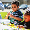Reno, left, 6 and Rikki, 4, Jones-Turner color eggs during the Easter event at First Baptist Church on Saturday. Staff Photo By Josh Hicks