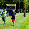 Clark County commissioners get nearly $900,000 from INDOT to build sidewalks in New Washington, ensuring students have more safe paths to walk to schools. Kindergartner Emiliano Martinez, left, and first grader Spencer Wood demonstrate a walk home from New Washington Elementary School on Tuesday. Staff Photo Illustration by Josh Hicks