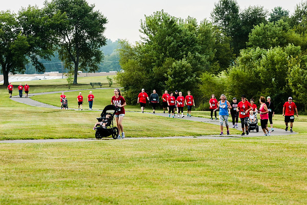 Around 90 participants gathered at Sam Peden Community Park in New Albany on Saturday to walk and run a course in honor of New Albany High School alumni.