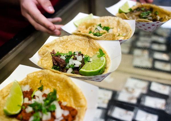 La Tiendita On Market lines up, from left to right, chorizo,  barbacoa, chicken and steak tacos during the Taco Walk in New Albany on Saturday.