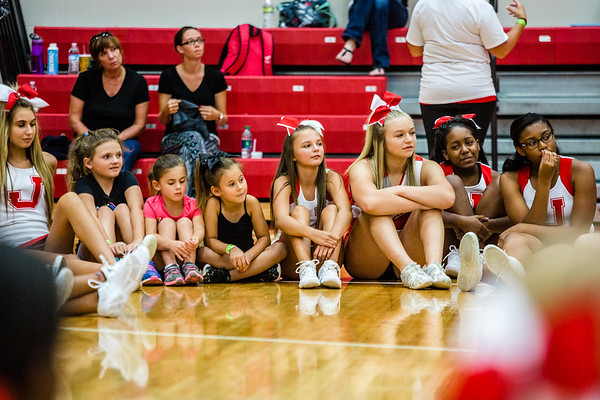 The high school cheer clinic leaders sit in a circle with the younger cheerleaders to introduce themselves before breaking up into groups.