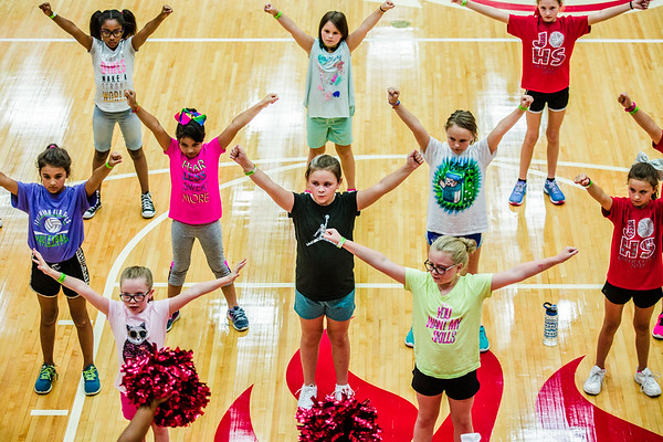 Around 80 preschool through fifth graders take to the Jeffersonville High School gymnasium for a cheer clinic led by high school cheerleaders on Thursday. Staff Photos By Josh Hicks