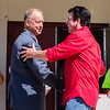 Mayor Mike Moore, left, and Papa John's Pizza founder and CEO John Schnatter shake hands after the naming of the John H. Schnatter Nachand Fieldhouse.
