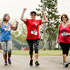 From left, Molly Hook, class of '67, Sharon Watkins, who ran for her father Homer Carpenter, class of '53, and Denal Pollard, class of '77, pick up the pace during New Albany High School alumni walk/run at Sam Peden Community Park on Saturday. Staff Photos By Josh Hicks