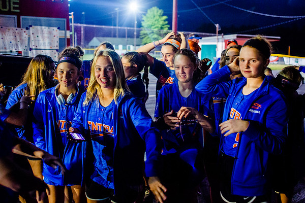 The Floyd Central girls pick out wads of silly string from their hair after getting of their bus.