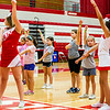 "A group of second graders learn the ""JHS"" cheer from two high school cheerleaders."