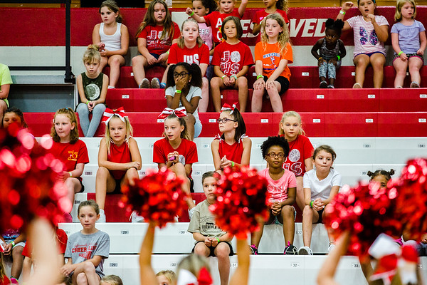 A bleacher full of young cheerleaders watch their high school mentors demonstrate the cheers and dances they are to learn on Thursday during the cheer clinic at Jeffersonville High School.
