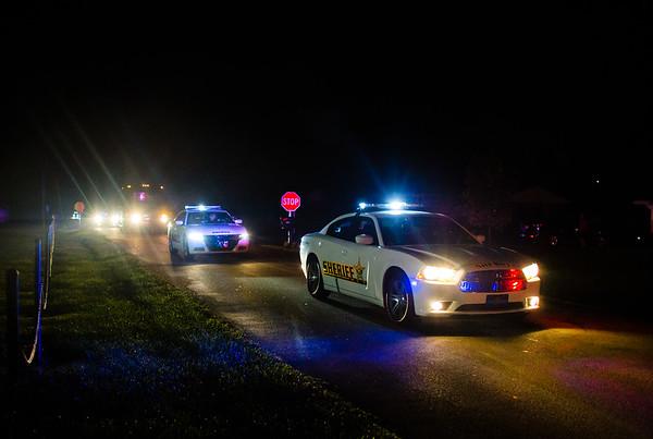 A police escort leads the Floyds Knobs Little League Softball Team to the Floyds Knobs Community Club.