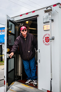 David McCormick of the Salvation Army exits a truck full of supplies to keep the firefighters fed, hydrated and warm during the Breakwater Apartment on Saturday. Staff Photo By Josh Hicks