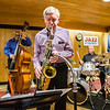 Jamey Abersold leads his jazz quartet with a saxaphone solo during a free concert they held at the New Albany Public Library on Tuesday. On bass, Jim Anderson. On drums, Jonathan Higgins. Staff Photo By Josh Hicks