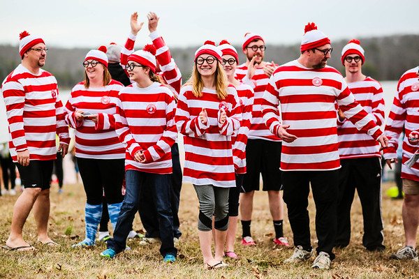 "Team ""Where's Hannah?"" assembles before the Special Olympic Polar Plunge at Deam Lake in Borden on Saturday. Staff Photo By Josh Hicks"