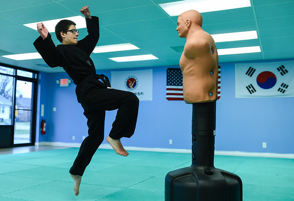Owen Somers, 12, leaps to land a kick on a striking dummy, standing just over six feet, while training at White Tiger Martial Arts in Clarksville. Staff photo by Tyler Stewart