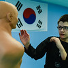 Owen Somers, 12, runs through striking and defensive techniques while training at White Tiger Martial Arts in Clarksville. Staff photo by Tyler Stewart