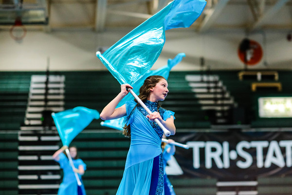 Floyd Central's Sophie Howie waves her flag during the Tri-State color guard competition at Floyd Central High School on Saturday. Staff Photo By Josh Hicks