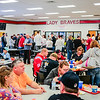 After braving the waters of Deam Lake, plungers and supporters gather at Borden High School to grab a bite to eat and participate in a raffle event. Staff Photo By Josh Hicks