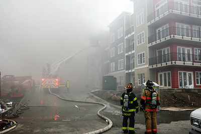 Thick smoke engulfs the east side of the Breakwater Apartments. Staff Photo By Josh Hicks