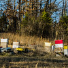Coloful beehives dot the hill behind Randy and Terri Lynch's bee and honey farm in New Albany. Staf Photo By Josh Hicks