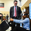 President of AT&T Indiana Bill Swoards laughs with freshman Alanna Groves as she makes her way through the distracted driving simulation at Jeffersonville High School on Monday. Staff photo by Tyler Stewart