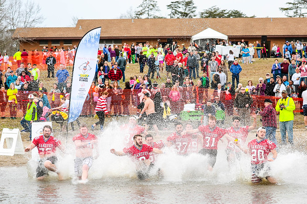 Hanover football players splash into Deam Lake during the Special Olympic Polar Plunge in Borden on Saturday. A total of 313 plungers made waves at the event that raised just over $84,000. Staff Photo By Josh Hicks