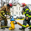 New Albany firefighters tap into another hydrant six hours after the fire started on Saturday. Staff Photo By Josh Hicks