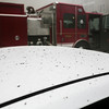 Debris from the Breakwater Apartment fire settles on the roof of a nearby vehicle. Staff Photo By Josh Hicks