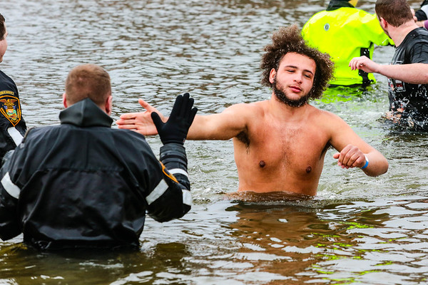 Christian Meyer represents Alpha Media during the Special Olympic Polar Plunge at Deam Lake in Borden on Saturday. Staff Photo By Josh Hicks