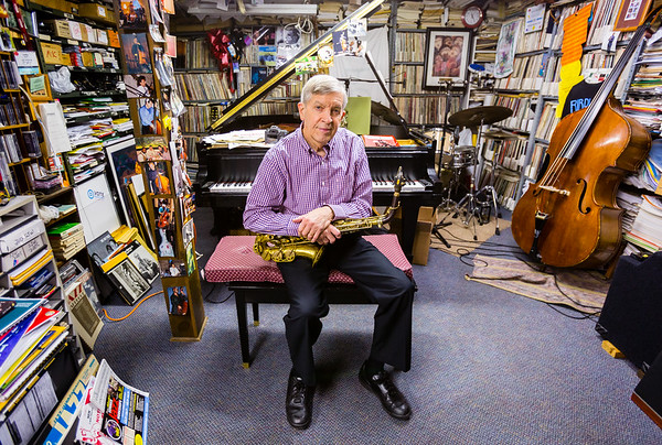 Jazz musician Jamey Aebersold sits with his saxaphone in his New Albany home studio. Staff Photo By Josh Hicks