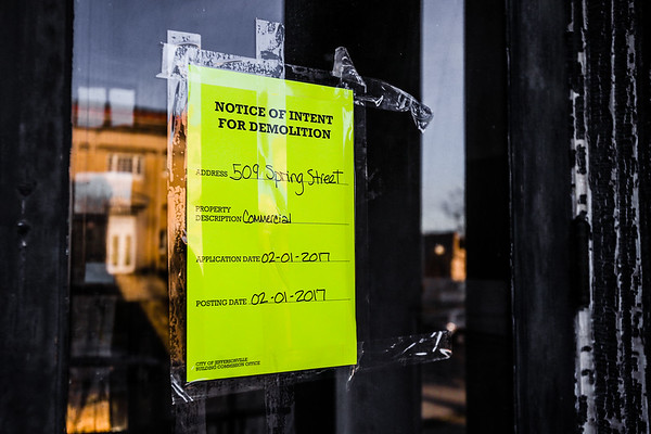 "A ""Notice of Intent For Demoltion"" sign hangs on the front door of the Jeffersonville Masonic Lodge Building. Staff Photo By Josh Hicks"