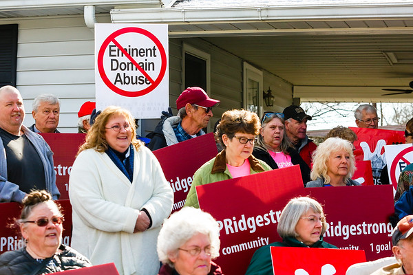 Pleasant Ridge residents gather in a neighborhood driveway for an announcement of a major development in the resident's lawsuit against the city of Charlestown on Friday. Staff Photo By Josh Hicks