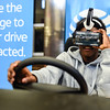 Freshman Ronnie Henderson holds onto the steering wheel as the virtual reality simulates distracted driving by use of smart phones while behind the wheel. AT&T came to the school as part of a nation-wide tour to promote safe driving. Staff photo by Tyler Stewart