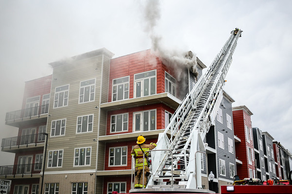 A Georgetown fire engine has its ladder extended to reach over the northeast side of the Breakwater Apartments on Saturday. Staff Photo By Josh Hicks