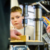 Tyler Braitling, 8, watches closely as his future Pinewood Derby firetruck race car actualizes under a drill at the Clarksville Fire Department on Saturday. Staff Photo By Josh Hicks