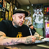 Rick Harlan, a 17-year tattoo artist veteran, works on a sketch at the Jeffersonville Tattoo Machine Gun location on Friday. Staff Photo By Josh Hicks