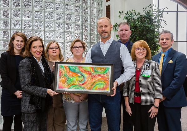 The Pat Harrison Resource Center also received a piece of artwork that was painted during the Power of Pink event in October, 2016. Staff Photo By Josh Hicks