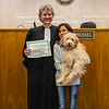 Judge Vicki Carmichael, left, and her adopted daughter Cleneth Lumenario stand in front of the Judge's bench after Lumenario adopted Bibble, their dog, at the Clark County Government Building on Saturday. Staff Photo By Josh Hicks