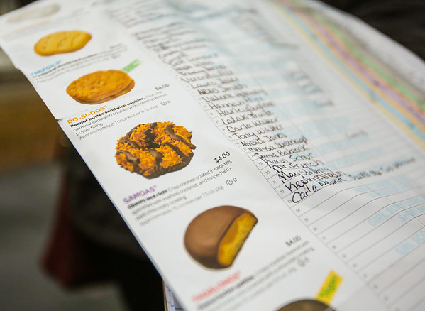 Girl Scout Cookie order forms don't just keep track of customers and the amount and types of cookies they purchase, but they also illustrate and describe the different types available. Staff Photo By Josh Hicks