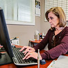 Terri Hughes, assistant manager at the Armstrong Farm Apartments in Jeffersonville, sits at her desk, sending an email on Thursday. Hughes says she has seen an increase in tenants interested in renting due to the tolls on I-65. The complex is located at 3900 Armstrong Ct. in Jeffersonville. For more information, please call 812-284-3900.<br /> Staff Photo By Josh Hicks