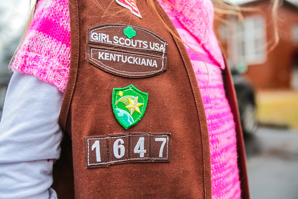 Jade, a Brownie Troop, wears a vest that denotes with patches the Girl Scout Troop to which she belongs. Staff Photo By Josh Hicks